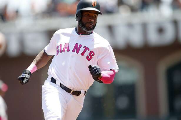 """San Francisco Giants"""" Denard Span rounds third base on a Joe Panik double against the Cincinnati Reds during the first inning of a baseball game in San Francisco, Sunday, May 14, 2017. (AP Photo/ Tony Avelar)"""