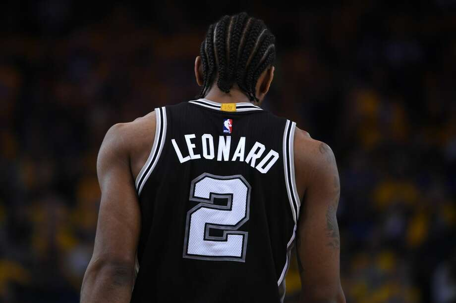 OAKLAND, CA - MAY 14:  Kawhi Leonard #2 of the San Antonio Spurs stands on the court during Game One of the NBA Western Conference Finals against the Golden State Warriors at ORACLE Arena on May 14, 2017 in Oakland, California. Photo: Thearon W. Henderson/Getty Images