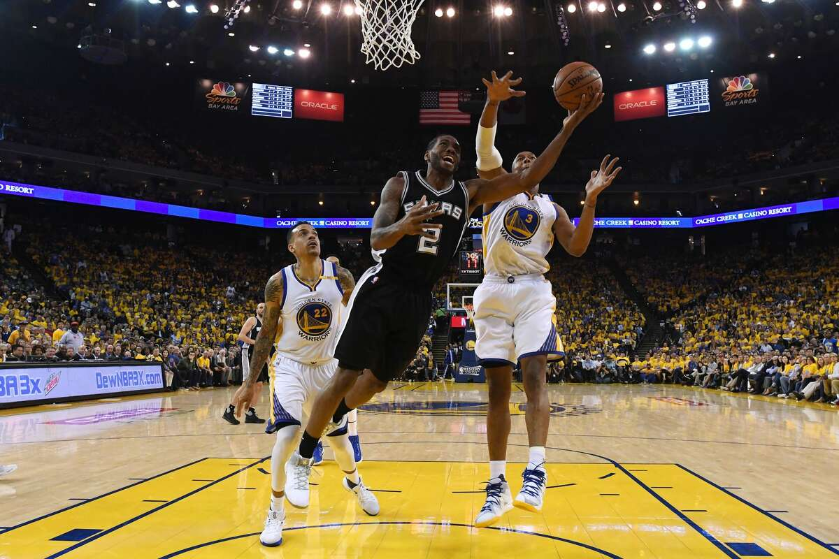 OAKLAND, CA - MAY 14: Kawhi Leonard #2 of the San Antonio Spurs throws up a shot against the Golden State Warriors during Game One of the NBA Western Conference Finals at ORACLE Arena on May 14, 2017 in Oakland, California. NOTE TO USER: User expressly acknowledges and agrees that, by downloading and or using this photograph, User is consenting to the terms and conditions of the Getty Images License Agreement. (Photo by Thearon W. Henderson/Getty Images)