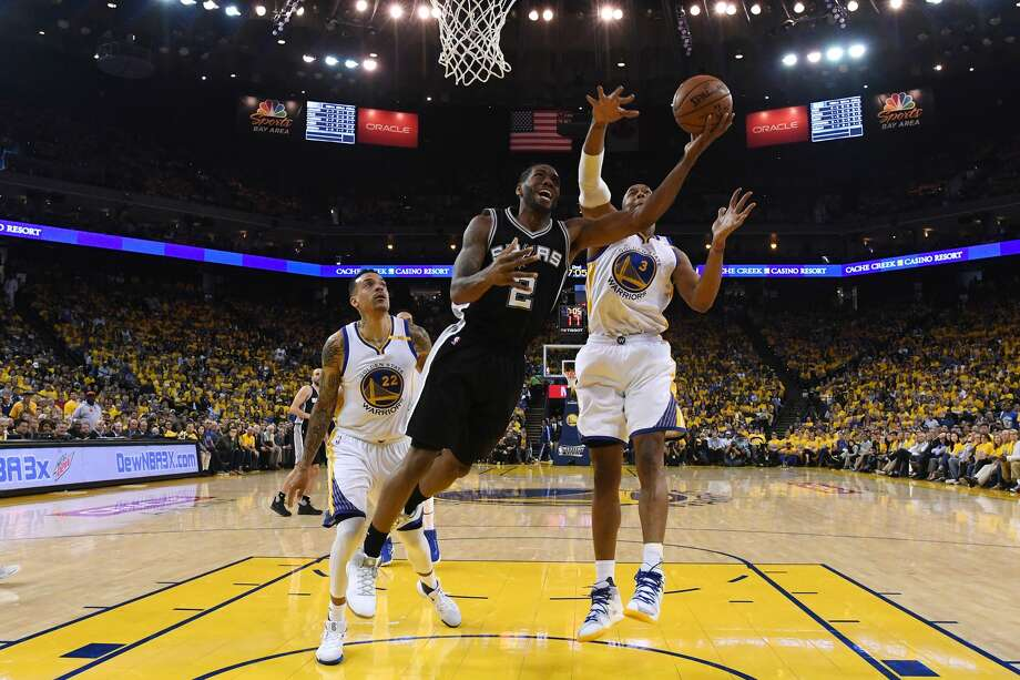 OAKLAND, CA - MAY 14:  Kawhi Leonard #2 of the San Antonio Spurs throws up a shot against the Golden State Warriors during Game One of the NBA Western Conference Finals at ORACLE Arena on May 14, 2017 in Oakland, California. NOTE TO USER: User expressly acknowledges and agrees that, by downloading and or using this photograph, User is consenting to the terms and conditions of the Getty Images License Agreement.  (Photo by Thearon W. Henderson/Getty Images) Photo: Thearon W. Henderson/Getty Images