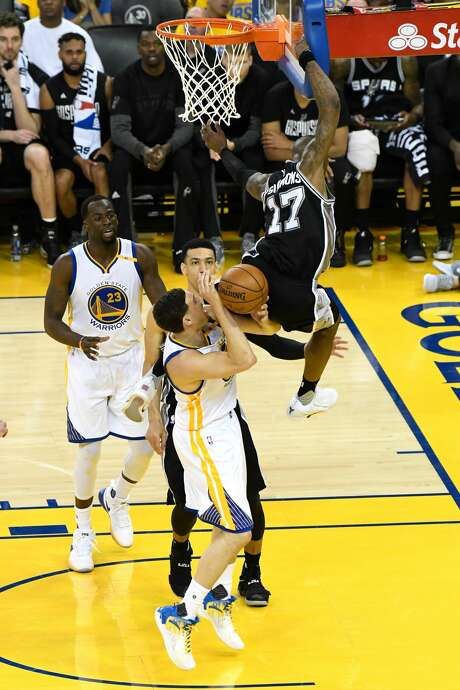 OAKLAND, CA - MAY 14:  Klay Thompson #11 of the Golden State Warriors is fouled by Jonathon Simmons #17 of the San Antonio Spurs during Game One of the NBA Western Conference Finals at ORACLE Arena on May 14, 2017 in Oakland, California. NOTE TO USER: User expressly acknowledges and agrees that, by downloading and or using this photograph, User is consenting to the terms and conditions of the Getty Images License Agreement.  (Photo by Thearon W. Henderson/Getty Images) Photo: Thearon W. Henderson/Getty Images