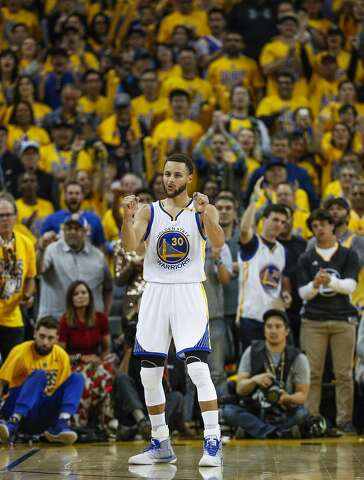 bdc5b6cb04b Golden State Warriors  Stephen Curry reacts in the fourth quarter during Game  1 of the