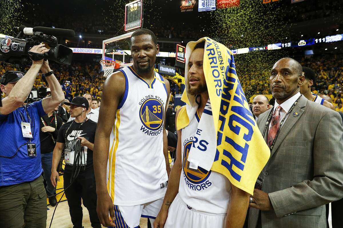 Golden State Warriors' Kevin Durant and Stephen Curry walk off the court after the Golden State Warriors defeated the San Antonio Spurs 113 to 111 in Game 1 of the 2017 NBA Playoffs Western Conference Finals at Oracle Arena on Sunday, May 14, 2017 in Oakland, Calif.