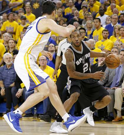 2e7c472db3eb San Antonio Spurs  Kawhi Leonard looks for room against Golden State  Warriors  Zaza Pachulia in May 2017 at Oracle Arena.