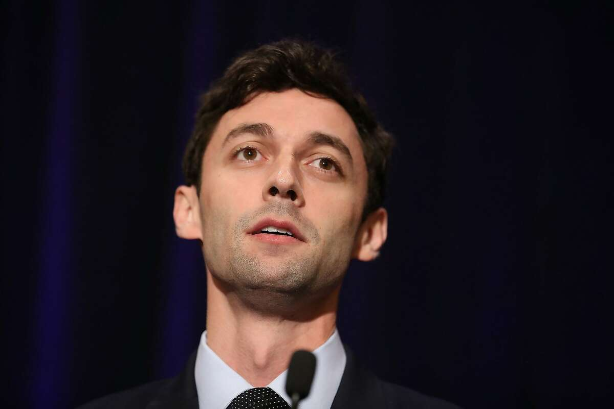 FILE-- Democratic candidate Jon Ossoff speaks to his supporters as votes continue to be counted in a race that was too close to call for Georgia's 6th Congressional District in a special election to replace Tom Price, who is now the secretary of Health and Human Services on April 18, 2017 in Atlanta, Georgia. The GOP used a San Francisco cable car for an attack ad on Ossaff, portraying him as a torchbearer for San Francisco liberals.