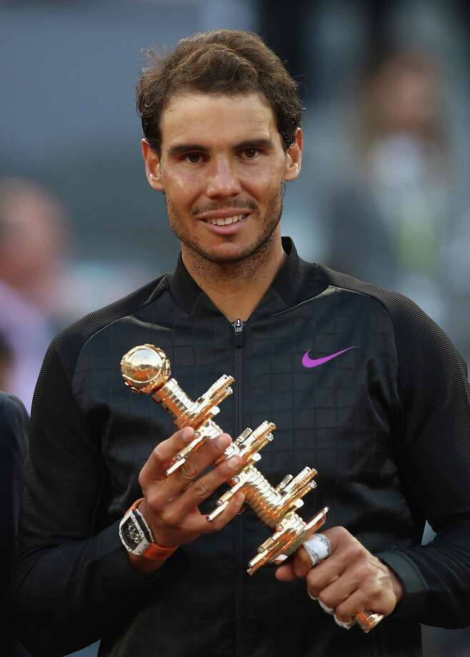 MADRID, SPAIN - MAY 14:  Rafael Nadal of Spain with the winners trophy after his win over Dominic Thiem of Austria in the final during day nine of the Mutua Madrid Open tennis at La Caja Magica on May 14, 2017 in Madrid, Spain.  (Photo by Julian Finney/Getty Images) ORG XMIT: 700038024 Photo: Julian Finney / 2017 Getty Images