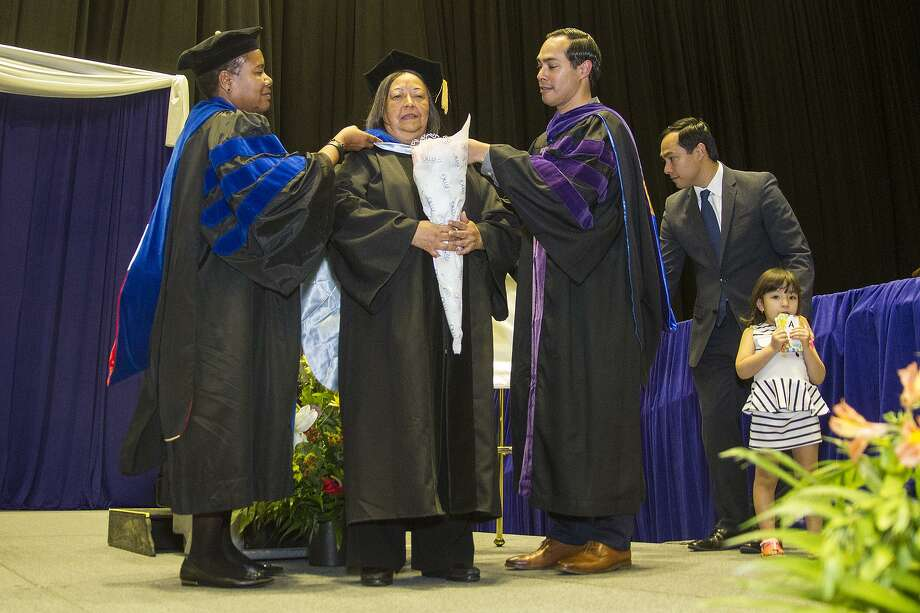 Rosie Castro (BA Spanish '71) is hooded by Provost and Vice President of Academic Affairs, Dr. Marcheta Evans (left) and her son, former mayor and Secretary of Housing and Urban Development, Julián Castro, and presented with an honorary doctorate, Sunday, May 14, 2017 as part of the Spring 2017 commencement ceremony for Our Lady of the Lake University at Freeman Coliseum. Photo: Alma E. Hernandez / For The San Antonio Express-News