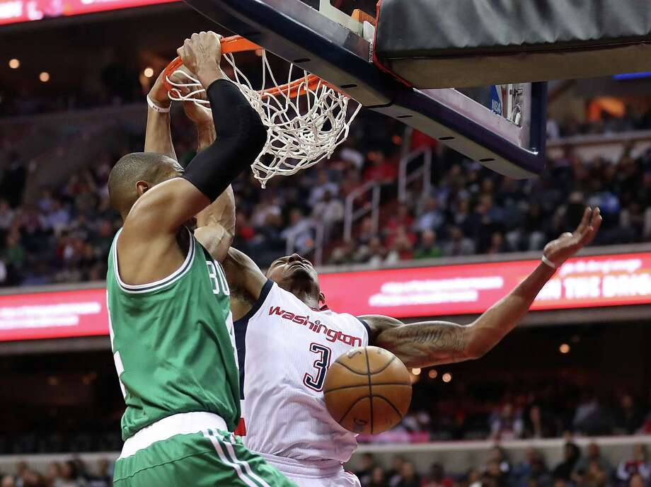 WASHINGTON, DC - MAY 12:  Al Horford #42 of the Boston Celtics dunks against Bradley Beal #3 of the Washington Wizards during Game Six of the NBA Eastern Conference Semi-Finals at Verizon Center on May 12, 2017 in Washington, DC.  NOTE TO USER: User expressly acknowledges and agrees that, by downloading and or using this photograph, User is consenting to the terms and conditions of the Getty Images License Agreement.  (Photo by Rob Carr/Getty Images) ORG XMIT: 700042695 Photo: Rob Carr / 2017 Getty Images