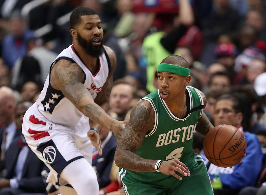 WASHINGTON, DC - MAY 12:  Isaiah Thomas #4 of the Boston Celtics is defended by Markieff Morris #5 of the Washington Wizards during Game Six of the NBA Eastern Conference Semi-Finals at Verizon Center on May 12, 2017 in Washington, DC.  NOTE TO USER: User expressly acknowledges and agrees that, by downloading and or using this photograph, User is consenting to the terms and conditions of the Getty Images License Agreement.  (Photo by Rob Carr/Getty Images) Photo: Rob Carr, Getty Images