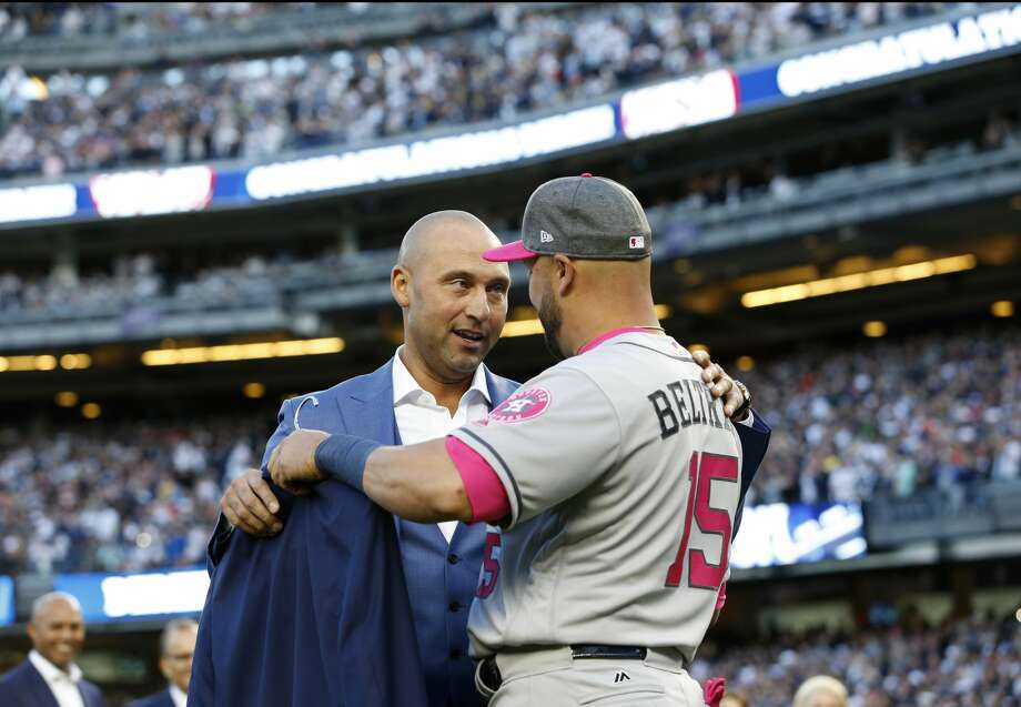 Retired New York Yankees shortstop Derek Jeter, left, talks with Houston Astros Carlos Beltran after Beltran presented Jeter with a jacket during a pregame ceremony retiring Jeter's number 2 in Monument Park at Yankee Stadium in New York, Sunday, May 14, 2017. (AP Photo/Kathy Willens, Pool) Photo: Kathy Willens/Associated Press