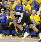 San Antonio Spurs' Kawhi Leonard reacts after tweaking his left ankle on a teammates foot after a play during second half action of Game 1 in the Western Conference Finals against the Golden State Warriors Sunday May 14, 2017 at Oracle Arena in Oakland, CA. The Warriors won 113-111.