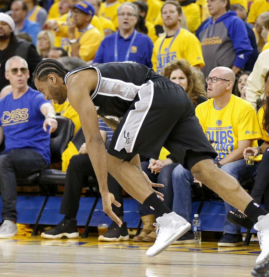 San Antonio Spurs' Kawhi Leonard reacts after tweaking his left ankle on a teammates foot after a play during second half action of Game 1 in the Western Conference Finals against the Golden State Warriors Sunday May 14, 2017 at Oracle Arena in Oakland, CA. The Warriors won 113-111. Photo: Edward A. Ornelas, San Antonio Express-News