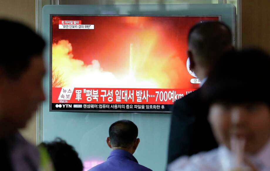 """People watch a TV news program showing a file image of a missile launch conducted by North Korea, at the Seoul Railway Station in Seoul, South Korea, Sunday, May 14, 2017. North Korea on Sunday test-launched a ballistic missile that landed in the Sea of Japan, the South Korean, Japanese and U.S. militaries said. The launch is a direct challenge to the new South Korean president elected four days ago and comes as U.S., Japanese and European navies gather for joint war games in the Pacific. The signs read: """"A missile was fired from near Kusong in North Phyongan province."""" (AP Photo/Ahn Young-joon) ORG XMIT: SEL102 Photo: Ahn Young-joon / Copyright 2017 The Associated Press. All rights reserved."""
