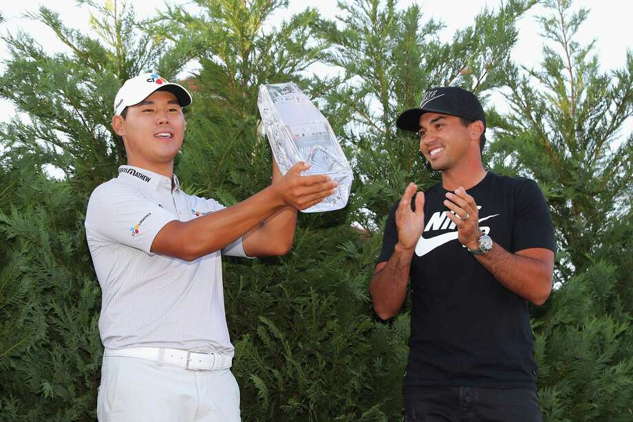 PONTE VEDRA BEACH, FL - MAY 14:  Jason Day (R) of Australia presents the winner's trophy to Si Woo Kim of South Korea after the final round of THE PLAYERS Championship at the Stadium course at TPC Sawgrass on May 14, 2017 in Ponte Vedra Beach, Florida.  (Photo by Warren Little/Getty Images) ORG XMIT: 686974089 Photo: Warren Little / 2017 Getty Images