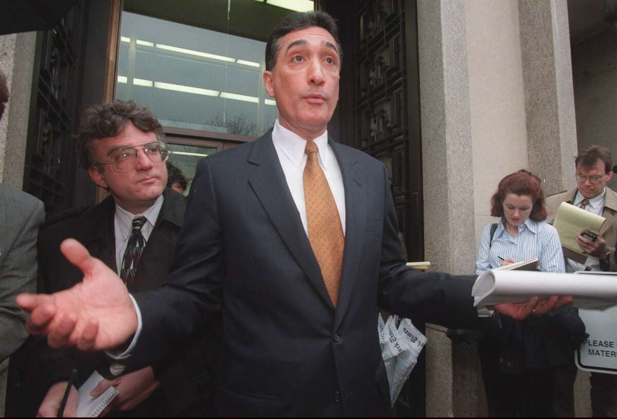 Former Housing Secretary Henry Cisneros gestures outside U.S. District Court in Washington Thursday Jan. 8, 1998 after pleading innocent to charges he lied to conceal payments to his former mistress while under consideration to be in President Clinton's Cabinet. (AP Photo/Ken Cedeno)