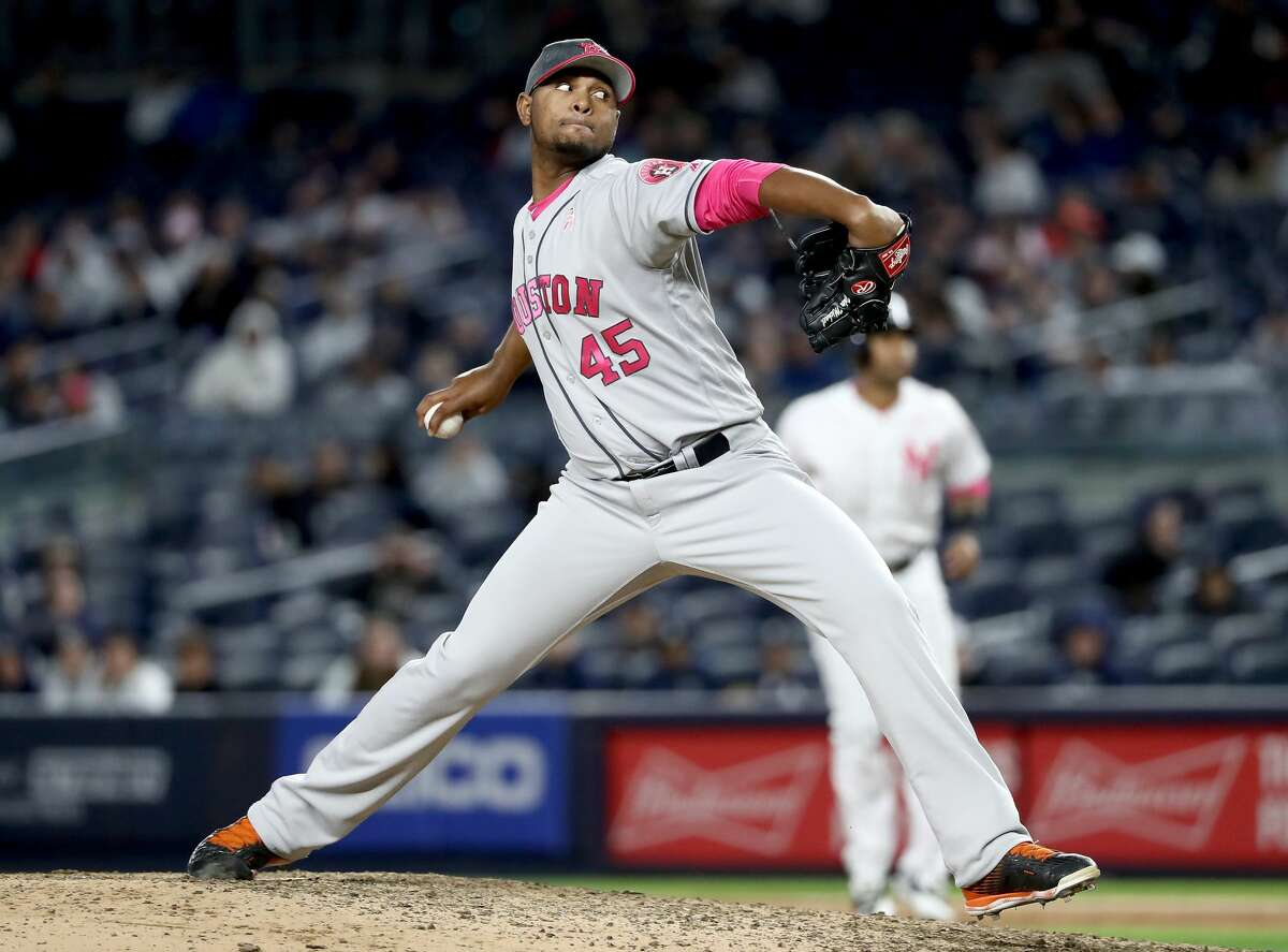 NEW YORK, NY - MAY 14: Michael Feliz #45 of the Houston Astros delivers a pitch in the sixth inning against the New York Yankees in Game 2 on May 14, 2017 at Yankee Stadium in the Bronx borough of New York City. (Photo by Elsa/Getty Images)