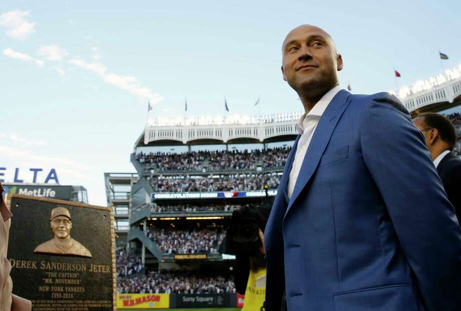 Retired New York Yankees shortstop Derek Jeter, right, looks around during a pregame ceremony after his No. 2 was retired in Monument Park at Yankee Stadium in New York, Sunday, May 14, 2017. The plaque is a replica of the one in Monument Park. (AP Photo/Pool, Kathy Willens) ORG XMIT: NYY101 Photo: Kathy Willens / Pool