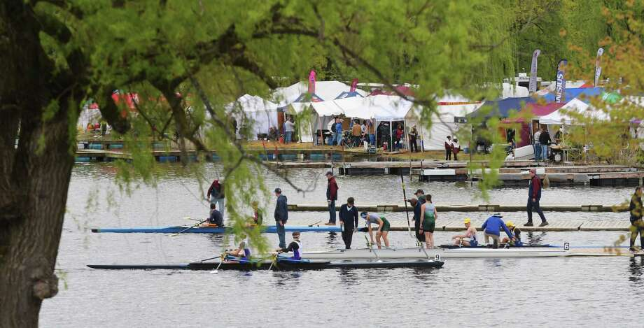 Racers get out of their boats after competing in the New York State Scholastic Rowing Association Championships on Fish Creek on Sunday, May 14, 2017, in Saratoga Springs, N.Y.   (Paul Buckowski / Times Union) Photo: PAUL BUCKOWSKI / 20040485A