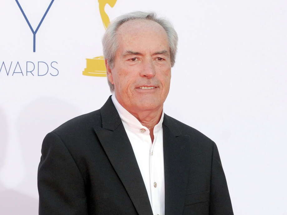 "FILE - In this Sept. 23, 2012 file photo, Powers Boothe arrives at the 64th Primetime Emmy Awards in Los Angeles. Boothe, the character actor known for his villain roles in TV's ""Deadwood,"" and in the movies ""Tombstone,"" ""Sin City"" and ""The Avengers,"" died Sunday, May 14, 2017. He was 68. (Photo by Jordan Strauss/Invision/AP, File) ORG XMIT: NYET501 Photo: Jordan Strauss, AP / Invision"