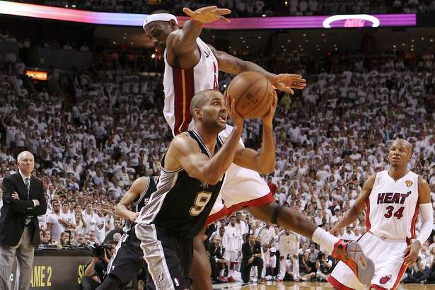 Tony Parker weaves around LeBron James to make a clutch shot in the 2013 NBA Finals.