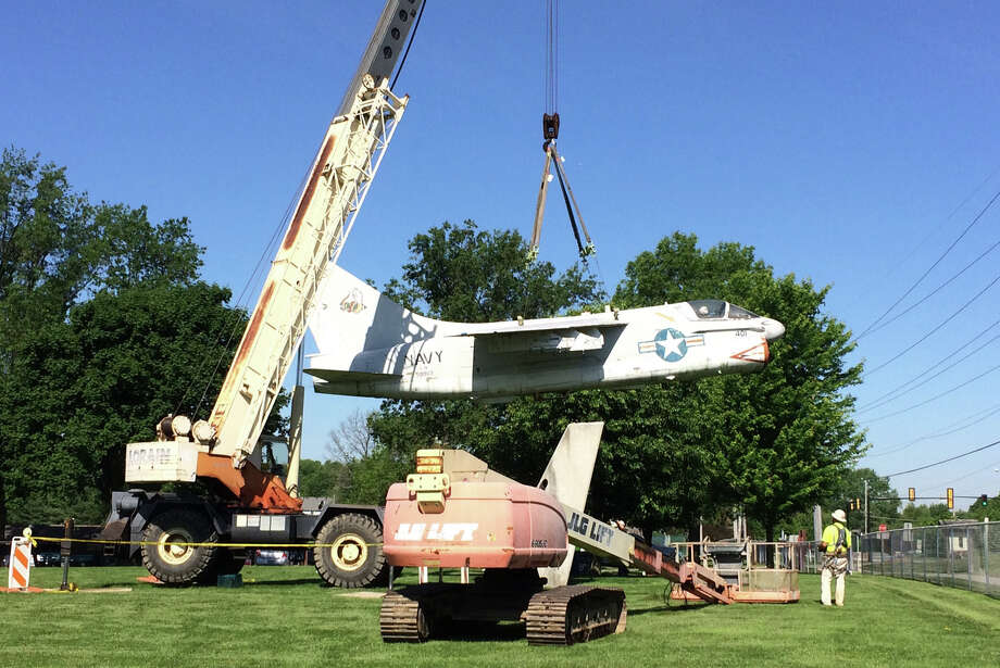 The U.S. Navy A7E Corsair on display at the Robert C. Stille Edwardsville Township Community Park was being lowered from the display pylon by Keller Construction so restoration work can begin.  The aircraft has remained on the pylon since it was originally installed in Township Park by Keller Construction in 1991. In October, Edwardsville Township approved a contract with the Flight Deck Veterans Group, a nationwide nonprofit organization based in Tennessee for the restoration of the historic aircraft on display at Township Park.  The Flight Deck Veterans Group restores aircraft as a part of its mission of veterans serving veterans and to pass on the history and legacy of veterans and flight deck operations. Photo: John Sommerhof • Intelligencer