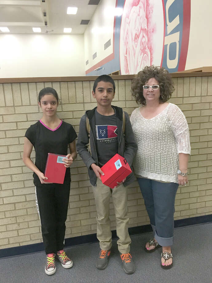 Nathalie Jaime and Juan Garcia Gamboa were perfect attendance award winners for the fifth and sixth six-weeks grading periods at Coronado Middle School. Presenting their prizes is Leigh Ann Bradley, representing Plainview Rotary which sponsors the contest.
