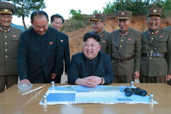 """This picture taken on May 14, 2017 and released from North Korea's official Korean Central News Agency (KCNA) on May 15 shows North Korean leader Kim Jong-Un (C) reacting during a test launch of a ground-to-ground medium long-range strategic ballistic rocket Hwasong-12 at an undisclosed location. / AFP PHOTO / KCNA VIA KNS / STR / South Korea OUT / REPUBLIC OF KOREA OUT   ---EDITORS NOTE--- RESTRICTED TO EDITORIAL USE - MANDATORY CREDIT """"AFP PHOTO/KCNA VIA KNS"""" - NO MARKETING NO ADVERTISING CAMPAIGNS - DISTRIBUTED AS A SERVICE TO CLIENTS THIS PICTURE WAS MADE AVAILABLE BY A THIRD PARTY. AFP CAN NOT INDEPENDENTLY VERIFY THE AUTHENTICITY, LOCATION, DATE AND CONTENT OF THIS IMAGE. THIS PHOTO IS DISTRIBUTED EXACTLY AS RECEIVED BY AFP.  / STR/AFP/Getty Images"""
