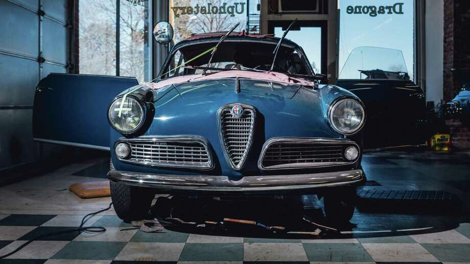 A 1959 Alfa Romeo 1600 receives new upholstery at the Dragone Restoration Facility in Bridgeport. Photo: Christopher Setter / For Hearst Connecticut Media / Christopher Setter/For Hearst Connecticut Media