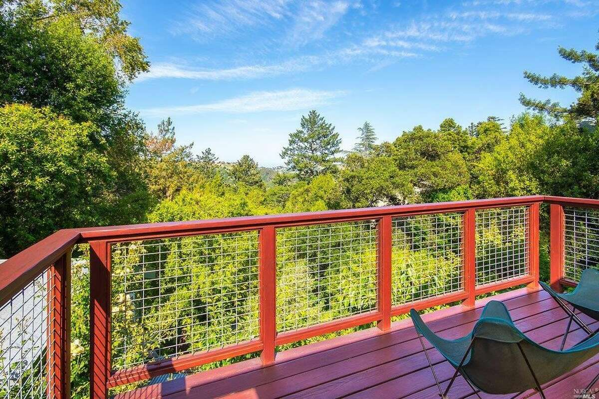 A three-bedroom, two-bathroom charmer with a large deck overlooking lush gardens at 130 Ridge Rd. in Fairfax. The 1,683-square-foot home is listed for $950,000.