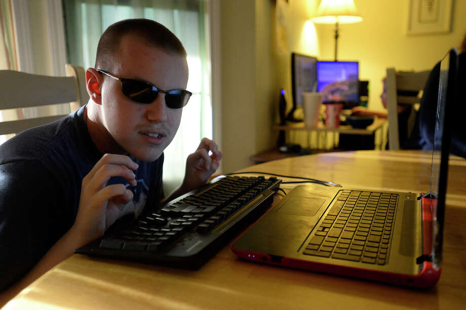 Colton Hill, 16, listens to the text-to-voice software on his computer at his family's home in Vidor on Wednesday evening. Hill, who is blind, uses his computer to compose electronic dance music.  Photo taken Wednesday 5/10/17 Ryan Pelham/The Enterprise Photo: Ryan Pelham / ©2017 The Beaumont Enterprise/Ryan Pelham