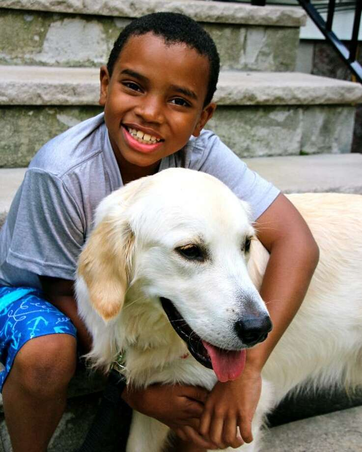 """The Buddy System"" is a documentary by Megan Smith-Harris, of Wilton, about service dogs who help children on the autism spectrum. Photo: Contributed Photo / Connecticut Post Contributed"