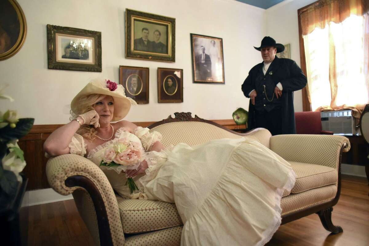 Sherry Lynn Jeffers poses for pictures after marrying Kevin Spross (right) at the Magnolia Hotel in Seguin on Saturday.