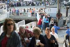 Festival patrons queue to board the Bridgeport-Port Jefferson Ferry at last year's Barnum Sails the Sound event. This year the cruise will take place Saturday, May 20