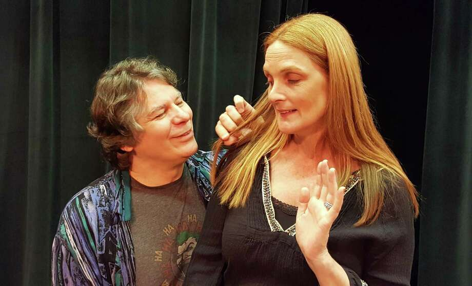 "Sean Hannon, of Weston, and Leigh Katz, of Westport, act out a scene from ""Spring Cleaning in Hell,"" by Norwalk playwright Mary Jane Schaefer. Photo: Theatre Artists Workshop / Contributed Photo / Connecticut Post contributed"