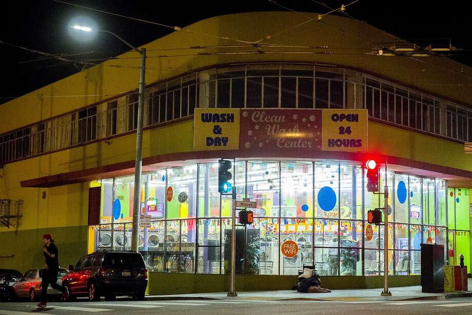 The Clean Wash Center on Sunday, May 14, 2017, in San Francisco, Calif. The wash-and-dry business is located at 4690 Mission Street. About 26 people who lived in alleged terrible conditions in the basement are now suing. Photo: Santiago Mejia, The Chronicle