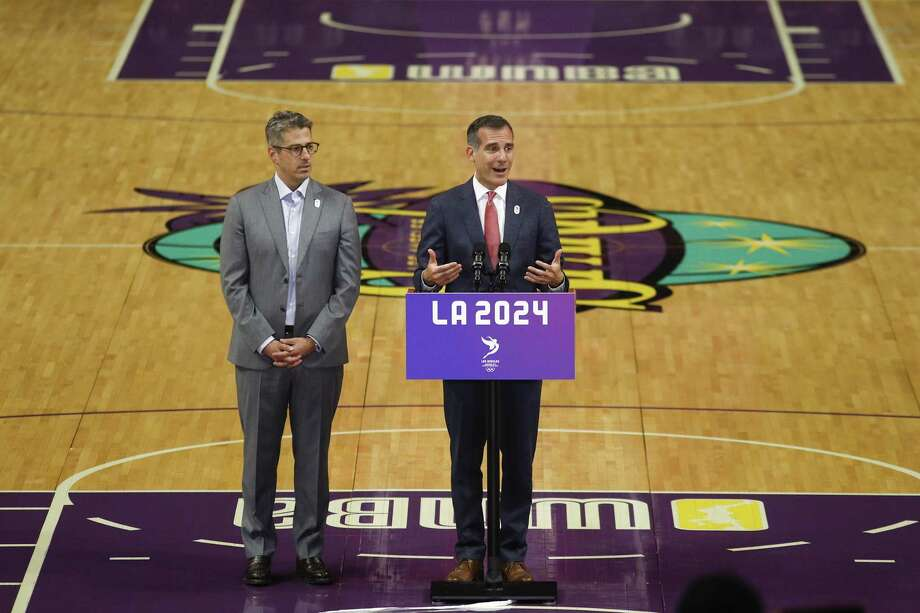 Los Angeles mayor Eric Garcetti, center, speaks as he is joined by Los Angeles 2024 chairman Casey Wasserman during a news conference at Staples Center on May 12, 2017, in Los Angeles. The International Olympic Committee officials wrapped up four days of evaluating Los Angeles' bid for the 2024 Games before heading to Paris to check the only other candidate. Photo: Jae C. Hong /Associated Press / Copyright 2017 The Associated Press. All rights reserved.