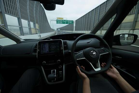 YOKOHAMA, JAPAN - MAY 15: San Francisco Chronicle reporter Wendy Lee drives a Serena minivan equipped with ProPilot mode during a highway test drive on May 15, 2017 in Yokohama, Japan. ProPilot has developed autonomous drive technology for highway mobility feature in the newest minivan model. Nissan aims to have this autonomous car technology for all roads conditions ready by 2020.