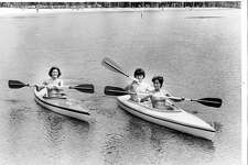 Kathy Pfauth of Saginaw, left, and Nanette Dupuis of Saginaw, get tips on kayak paddling from Peter Friedrich at Sanford Lake. Unknown date