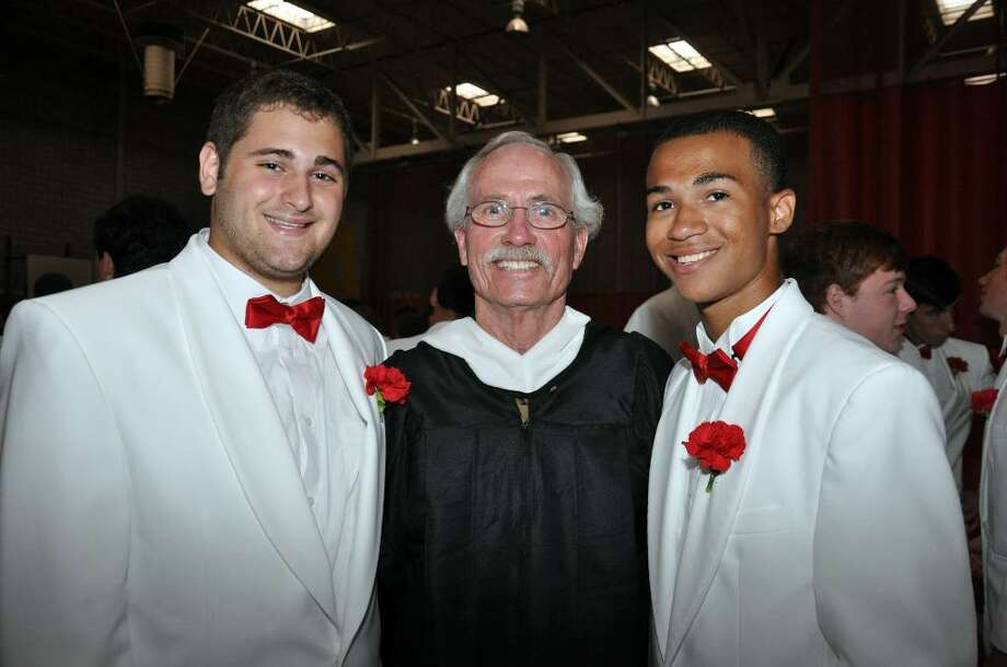 Alex Wolfe, of Fairfield and Josh White, of Bridgeport, pose with Housemaster John Brennan, center, before Fairfield College Preparatory School's 68th Commencement ceremony on Sunday, June 6, 2010. Photo: Amy Mortensen / Connecticut Post Freelance