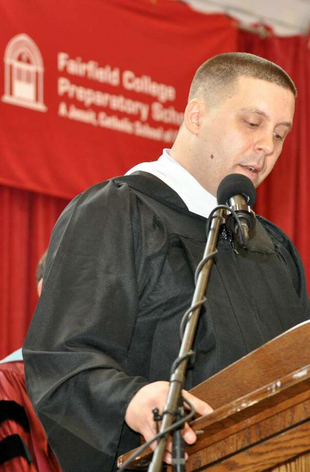 Elliott Gualtiere, Director of Campus Ministry, delivers the invocation during Fairfield College Preparatory School's 68th Commencement ceremony on Sunday, June 6, 2010. Photo: Amy Mortensen / Connecticut Post Freelance