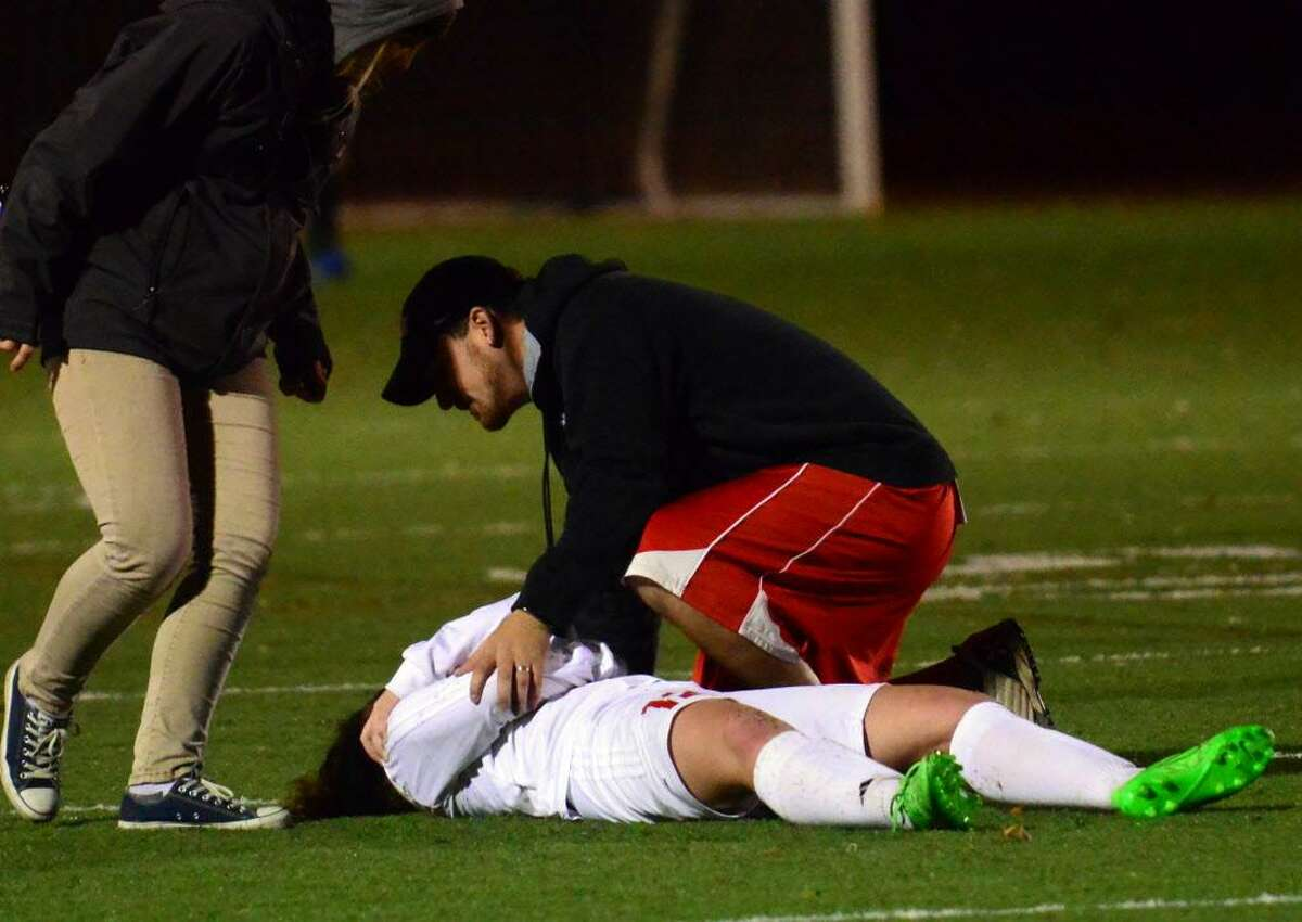 Second round of CIAC Girls Soccer Tournament action in Fairfield, Conn., on Wednesday Nov. 11, 2015. injury
