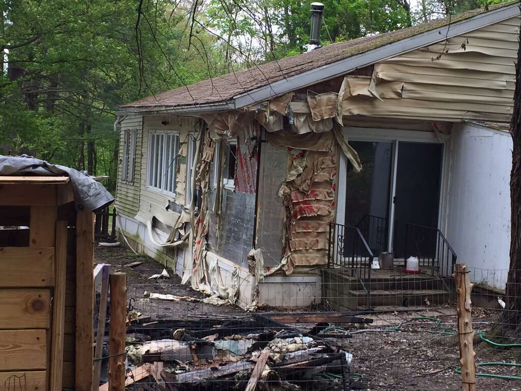 A black family woke up Sunday night to find their detached garage sprayed with hateful graffiti and engulfed in flames, Schodack Police Chief Joseph Belardo said Monday, May 15, 2017. The parents and their five children — who are all under the age of 10 — were physically unharmed but emotionally traumatized by the fire set at 29 Cold Spring Ave., the chief said. (Robert M. Gavin/Times Union) Photo: Robert Gavin