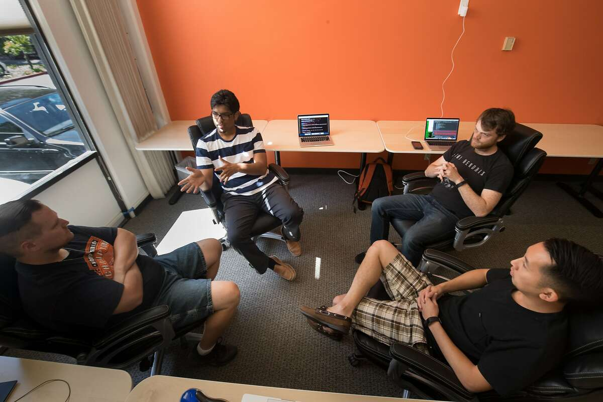Prateek Joshi, founder of Pluto AI, meets with his engineer team, Geoff Neal, Ian Conway and Jimmy Nguyen in his new office on Monday, May 15, 2017 in Palo Alto, CA.
