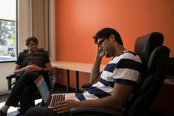 Prateek Joshi, founder of Pluto AI, at a meeting with his engineering team in his new office on Monday, May 15, 2017 in Palo Alto, CA.  At left is Ian Conway.