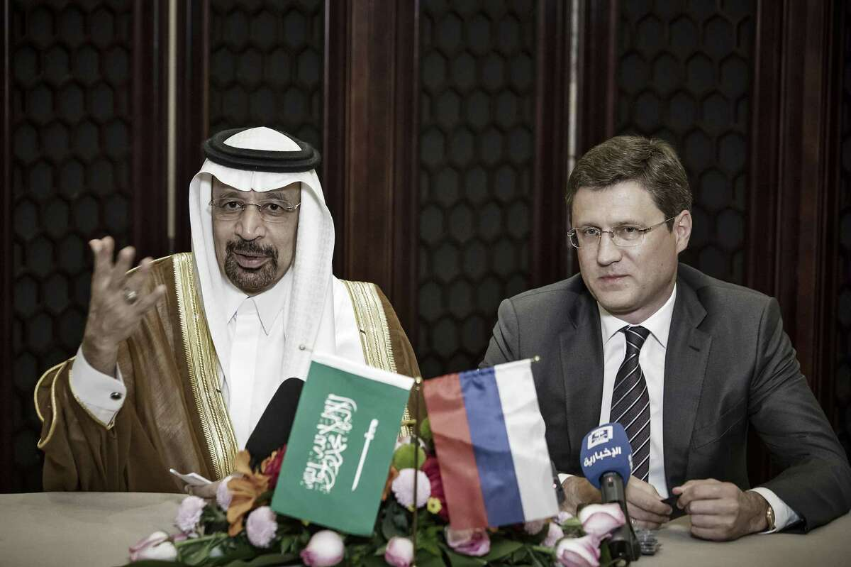 Khalid Bin Abdulaziz Al-Falih, Saudi Arabia's energy minister, left, speaks as Alexander Novak, Russia's energy minister, looks on during a news conference on the sidelines of the Belt and Road Forum for International Cooperation in Beijing, China, on Monday. The two countries said they would support extending 1.8 million barrels in oil production cuts that were set to expire in June.