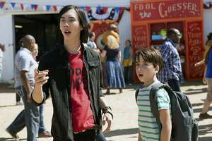 """This image released by Twentieth Century Fox shows Charlie Wright, left, and Jason Drucker in a scene from, """"Diary of a Wimpy Kid: The Long Haul."""" (Daniel McFadden/Twentieth Century Fox via AP)"""