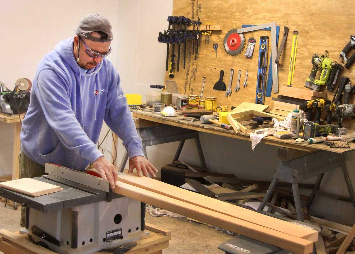 """Jeffrey """"Gus"""" Sackett cuts wood with a table saw at his shop and showroom, Greenworks Woodworking, on Monday, May 15, 2017, on Main Street in Danbury, Conn."""