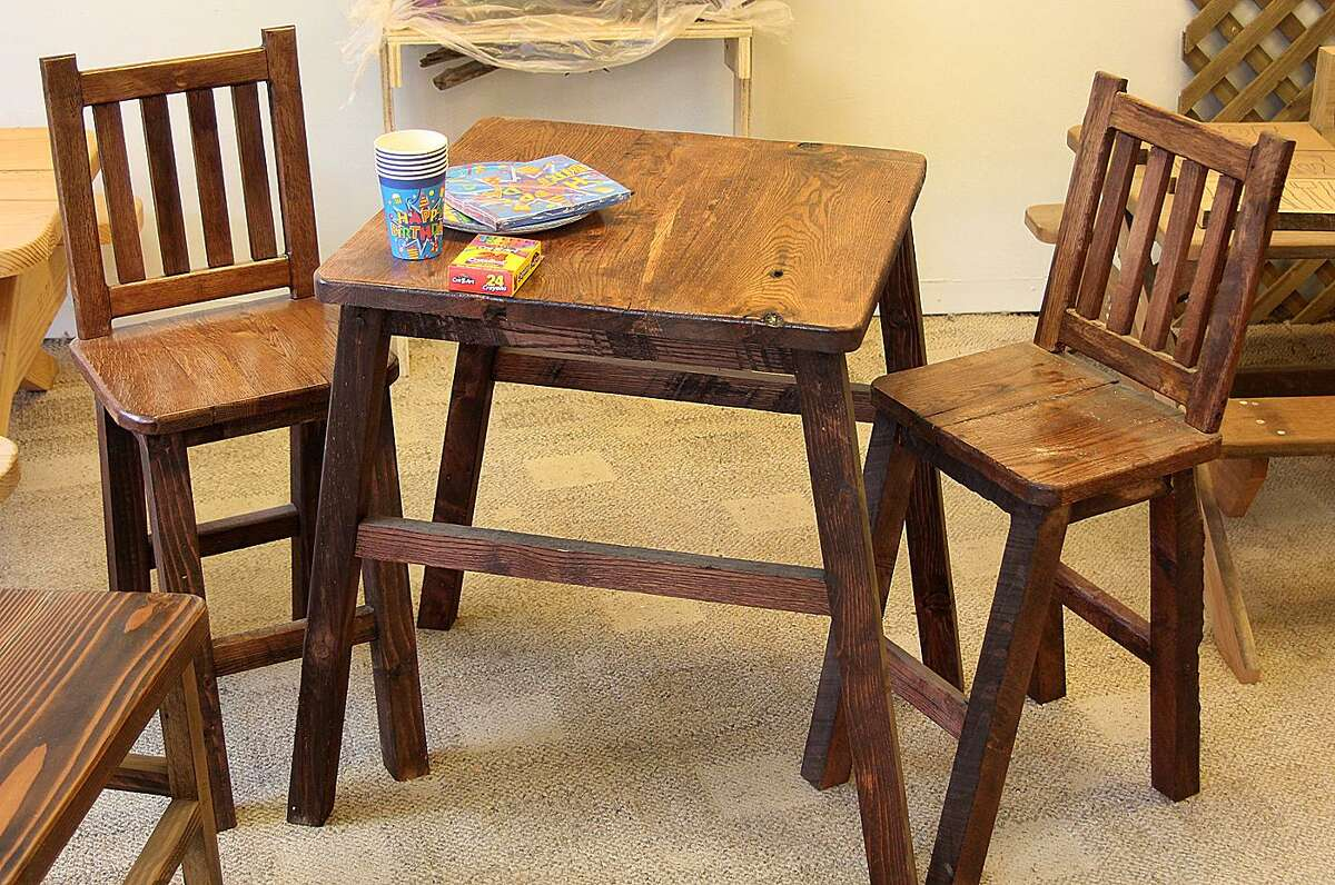 A child's table and chairs set made by hand from recycled wood as seen on Monday, May 15, 2017, at Greenworks Woodworking on Main Street in Danbury, Conn.