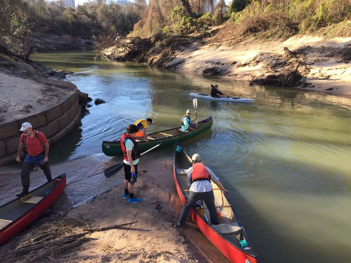 In this photo: Paul Hung and other scouts load into canoes on Buffalo Bayou.