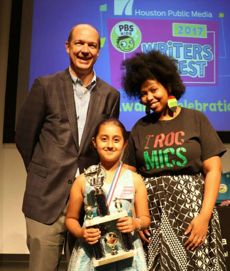 Priya Sekhri, a third-grader at Barbara Bush Elementary, won first-place in the 2017 Houston Public Media PBS KIDS Writers Contest. From left are Josh Adams, executive director of operations of Houston Public Media, Sekhri and Houston's Poet Laureate Deborah D.E.E.P.  Mouton Photo: Houston Public Media